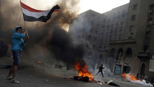 Tyres burn as protesters take part in clashes with riot police in Cairo