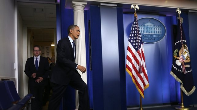 President Obama accused Republicans of using threats and extortion