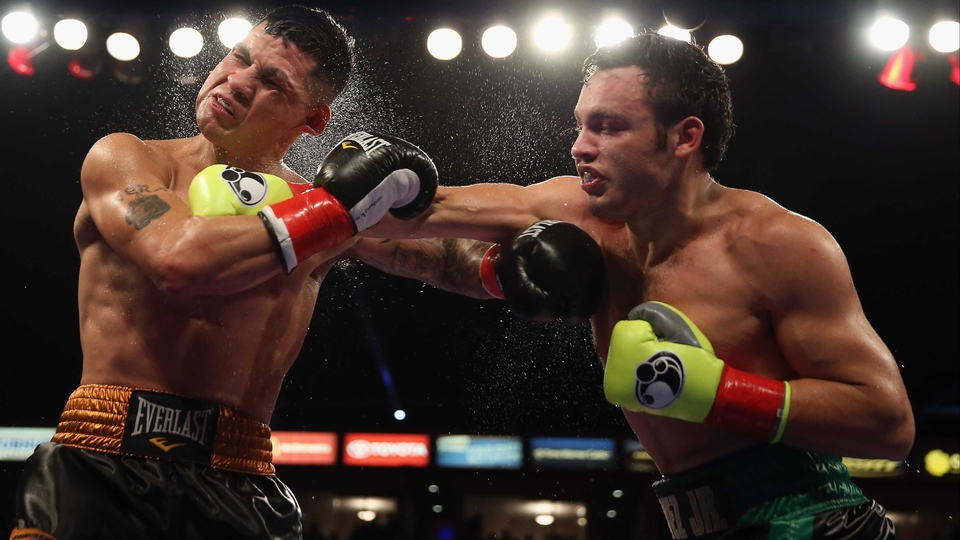 Julio Cesar Chavez Jr. (r) lands a right hand to the head of Brian Vera