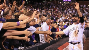 Todd Helton #17 of the Colorado Rockies greets the fans after he played his last home game at Coors Field