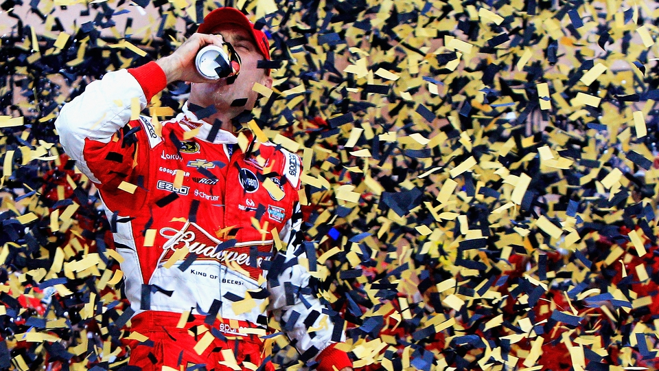 Kevin Harvick celebrates in Victory Lane after winning the NASCAR Sprint Cup Series at Kansas Speedway
