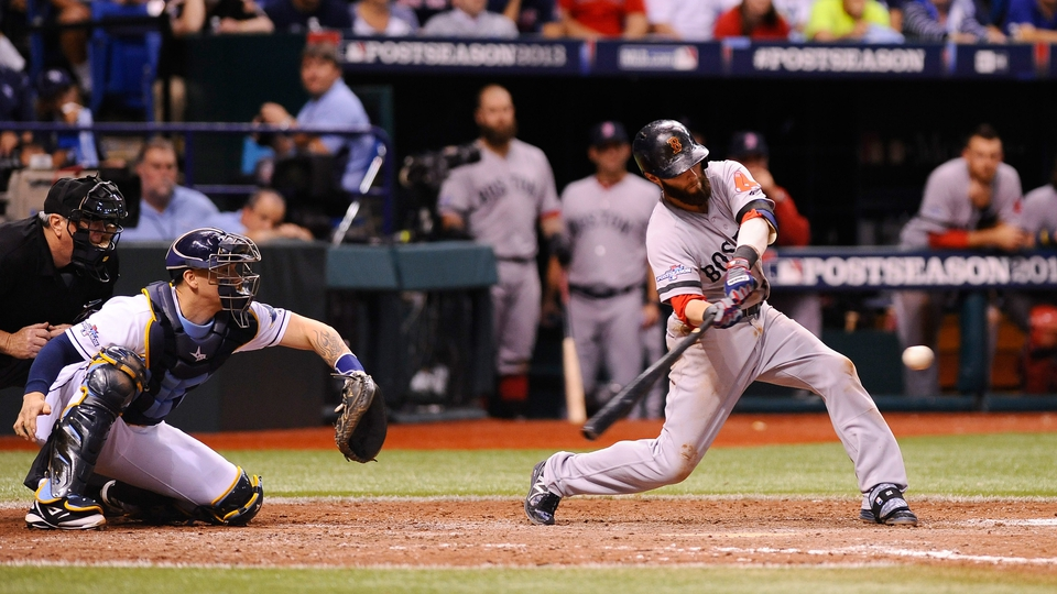 Jacoby Ellsbury of the Boston Red Sox hits a ground ball to score the tying run in the ninth inning against the Tampa Bay Rays