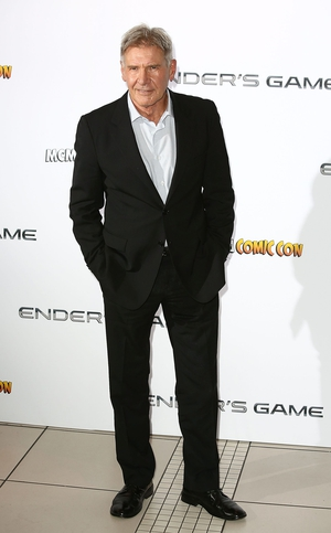 Harrison Ford defended his new film Ender's Game saying it does not represent the controversial views of the film's writer Orson Scott Card
