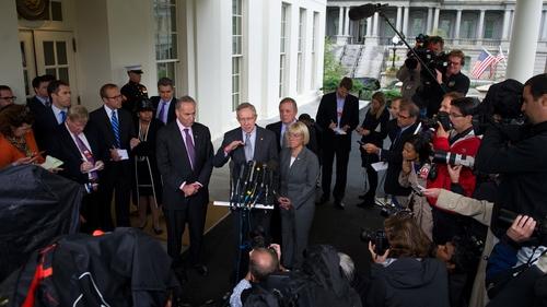 Senate Majority Leader Harry Reid speaks to the press after meeting with US President Barack Obama