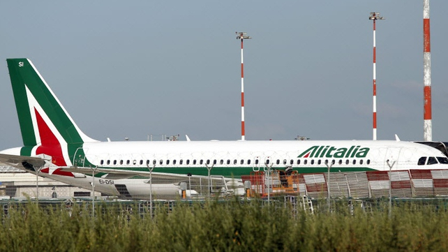 Air France-KLM has written off the value of its stake in struggling Alitalia