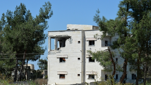 A damaged building in Latakia