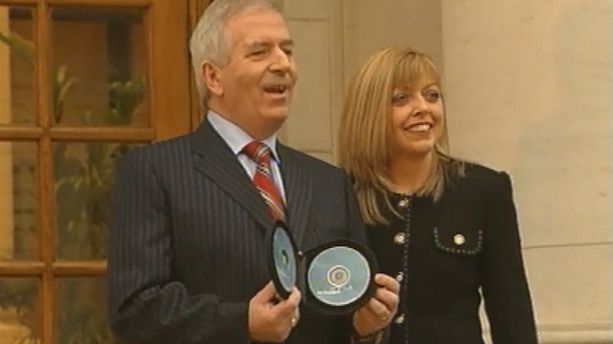 Charlie McCreevy and his wife, Noeleen Halligan, pictured on the steps to Dail Eireann presenting Budget 2004.