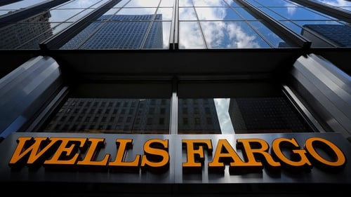 Wells Fargo said its revenue fell to $21.9 billion from $22.3 billion a year earlier