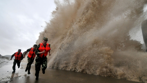 A huge wave hits a dyke as Typhoon Fitow moves to make its landfall in Wenling in eastern China