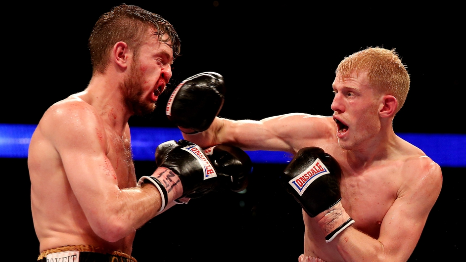 Tony Owen catches Danny Connor with a right hook during their fight at O2 Arena in London