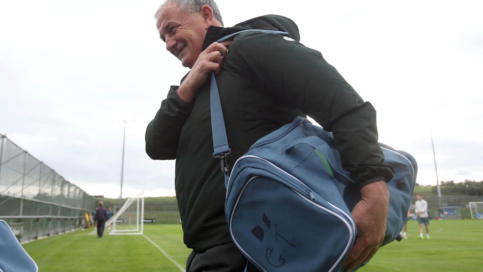 Republic of Ireland interim manager Noel King leaves training carrying the bag of his predecessor Giovanni Trapattoni