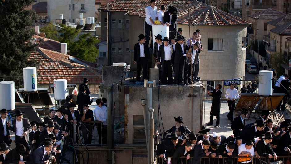 Jewish mourners observe the funeral of Rabbi Ovadia Yosef in Jerusalem