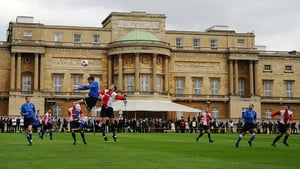 Polytechnic FC play Civil Service FC in a football match in the grounds of Buckingham Palace to mark the English FA's 150th anniversary