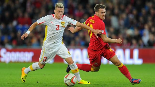 Wales player Aaron Ramsey (r) challenges Ezgjan Alioski of Macedonia