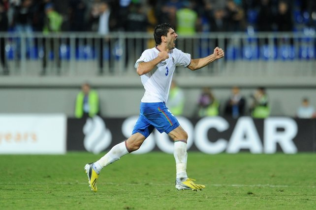 Azerbaijan's Rasim Ramaldanov celebrates at the final whistle