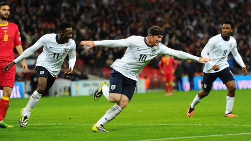 Wayne Rooney celebrates scoring England's first goal with team-mate Danny Welbeck