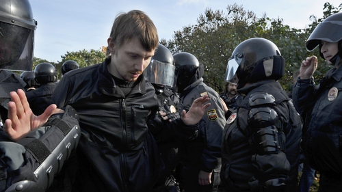 Russian police arrested pro and anti-gay rights activists after clashes