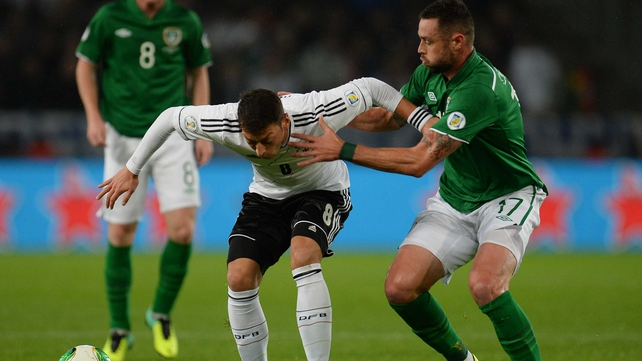 Damien Delaney tries to get the better of German play-maker Mesut Ozil