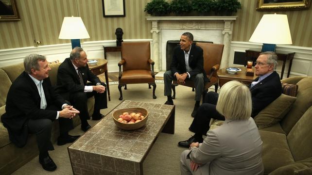 US President Barack Obama meets Democratic senators in the White House for talks to try to break the shutdown impasse