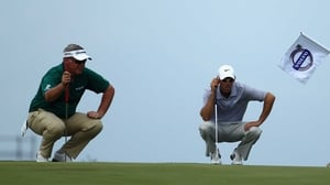 Darren Clarke (l) bogeyed the 17th as Charl Schwartel (r) went on to win in China