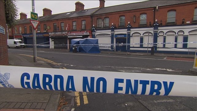 Gardaí say gunman opened fire indiscriminately after shooting a man in the head, also injuring three women