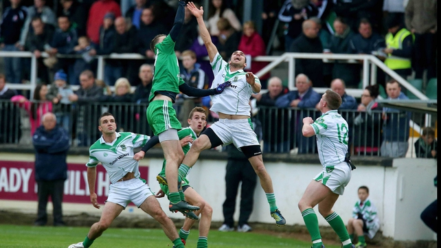 Moorefield's James Longergan (l) and Declan McKenna of Sarsfields contest a high ball