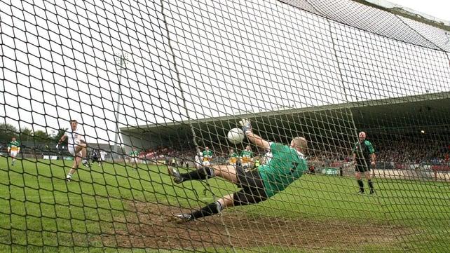 Carrickmore goalkeeper Plunkett McCallan saves a penalty taken by Colm Doris of Clonoe