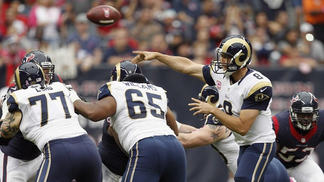 Sam Bradford of the St Louis Rams throws a pass against the Houston Texans at Reliant Stadium