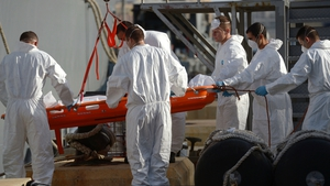 A body is recovered from the sea after last week's drownings in the Mediterranean