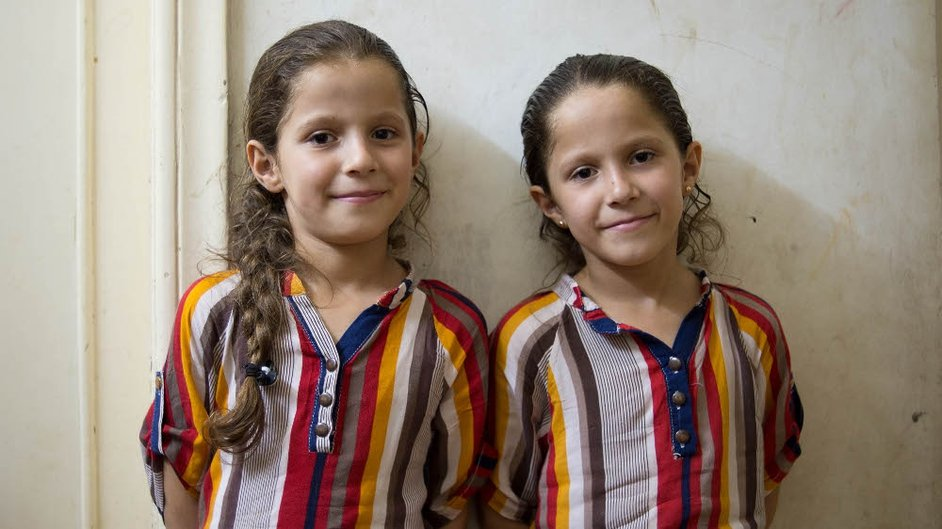 Twins Maya and Mai, aged eight, who live in Irbid
