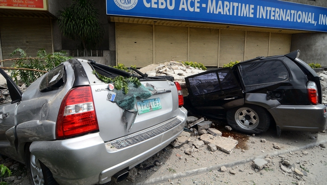 Cars damaged by falling debris in downtown Cebu City, Philippines