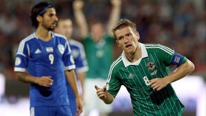 Steven Davis wheels away after scoring Northern Ireland's equaliser in Tel Aviv