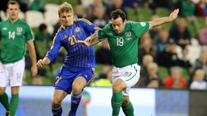Andy Reid broke with recent tradition for an Irish central midfielder on Tuesday by looking to get on the ball