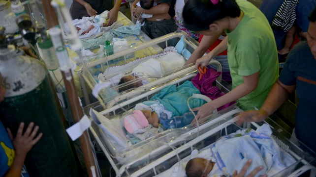 Newborn babies are treated at a temporary shelter after a hospital was damaged