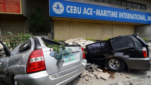 Cars damaged by falling debris in downtown Cebu City