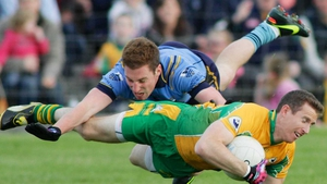 Players in flight - Gearoid Canavan of Salthill Knocknacarra (blue) and Gary Sice of Corofin during the Galway football final