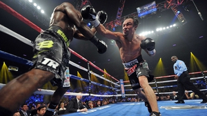 Reaching out - Juan Manuel Marquez (R) swings at WBO welterweight champion Timothy Bradley Jr during their bout in Las Vegas
