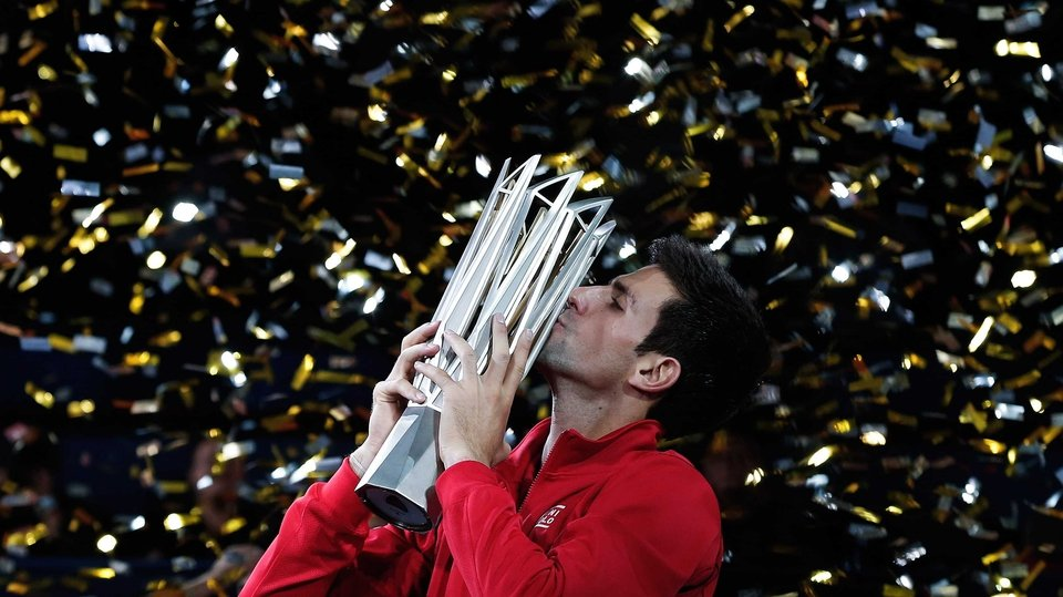 Novak Djokovic of Serbia poses with the winner's trophy after defeating Juan Martin in the final of the Shanghai Rolex Masters
