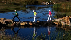 Follow me lads! - Stephen Gallacher of Scotland (l), Jamie Donaldson of Wales and Tommy Fleetwood of England use some stepping stones to cross the water at the Portugal Masters