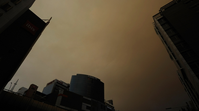 Smoke from wildfires fills the sky over Sydney
