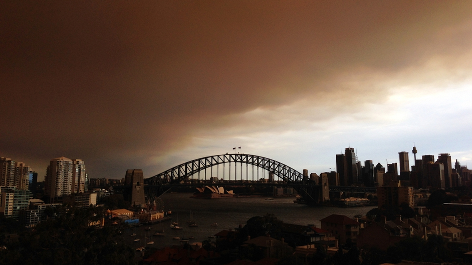 Smoke and ash fill the sky over the Sydney Harbour Bridge