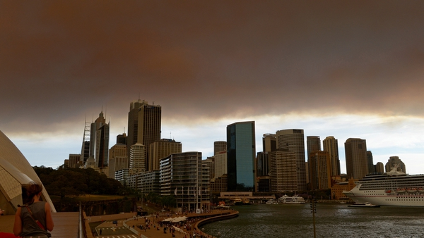 Thick smoke from fires in the Blue Mountains is seen across the Sydney skyline