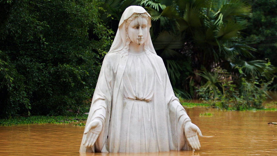 A statue of the Virgin Mary in the flooded garden of a Catholic family in Huong Khe district of Vietnam