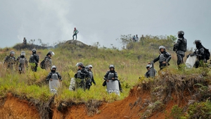 Riot police stand by as natives block the Panamerican highway, in Mondomo, Colombia