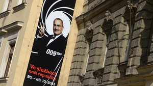 An election campaign banner reading 'In the service of our country' featuring the chairman of the conservative Top 09 party Karel Schwarzenberg is fixed at a house in Prague