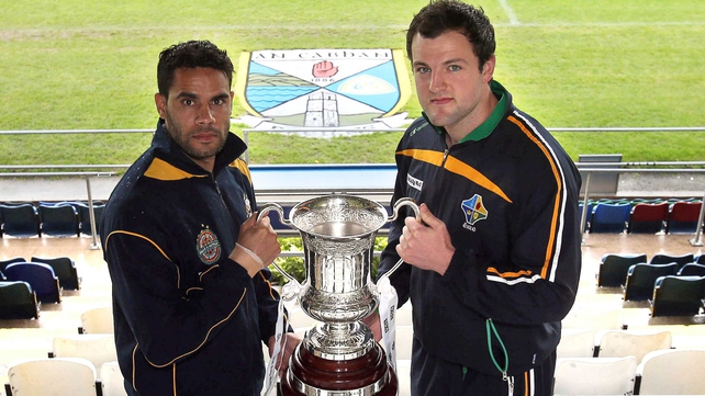 Australia captain Daniel Wells and Ireland captain Michael Murphy with the Cormac McAnallen Perpetual Cup