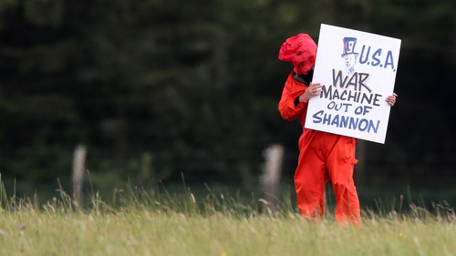 Irish law permits military aircraft to land at Shannon provided planes are unarmed