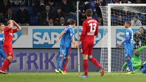 Bayer Leverkusen's Stefan Kiessling holds his head in his hands, still unaware that his off-target header has breached the Hoffenheim side-netting