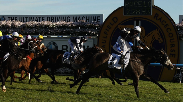 The blinkered Fawkner (10-1) landed the world's richest mile-and-a-half handicap under Nicholas Hall