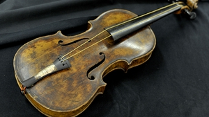 Violin played as Titanic sank fetches record price at auction